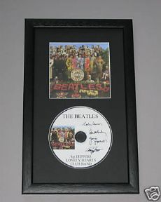 THE BEATLES - SGT PEPPER'S LONELY HEARTS CLUB BAND CD DISC MEMORABILIA presentation